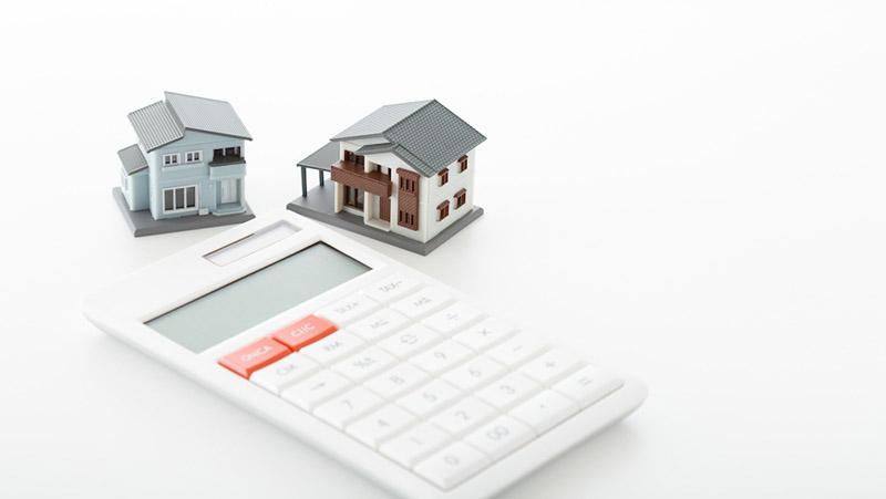 アルヒマガジンメインイメージ(電卓とミニチュアの家)